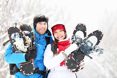 couple with snowshoes